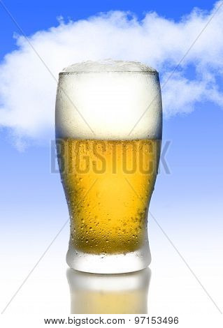 One Golden Beer With Frost And Bubbles In Full Tempting Glass With White Foam Isolated On Blue Sky