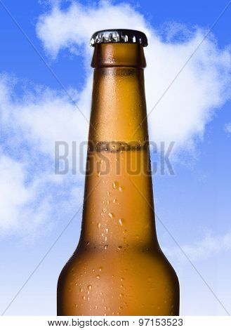 Macro Beer Golden Bottle Neck With Frost And Bubbles In Brown Glass Isolated On Blue Sky