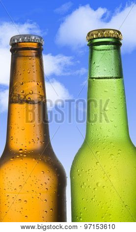 Two Cold Frosted Beer In Green And Golden Brown Bottle Frosted And Tempting