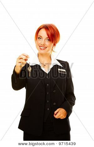 Caucasian Woman As Hotel Worker Offering Key