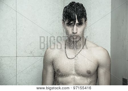 Attractive Young Athletic Man Taking Shower