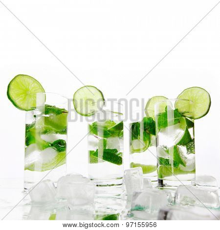 Party mojito cocktails with lime and mint isolated on white background