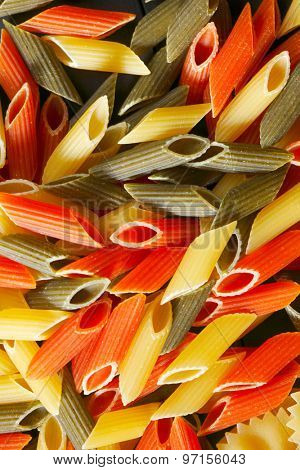 Variety of types and shapes of Italian pasta on black table