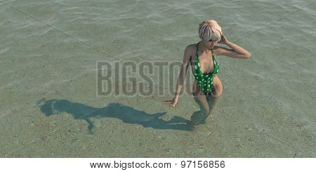 young blonde wearing green swimsuite standing in water