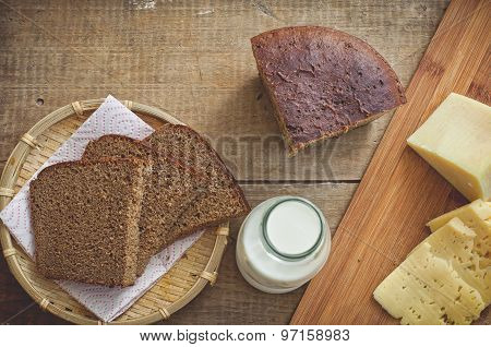 Sliced Cheese, Rye Bread And Milk