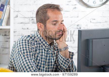 A Young Engineer Pensive At His Computer