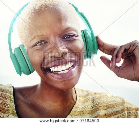 African Woman Headphones Listening Music Concept