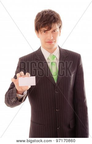 Young Man In Striped Suit And Tie Demonstrates Personal Card
