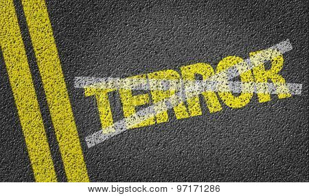 Terror written on the road