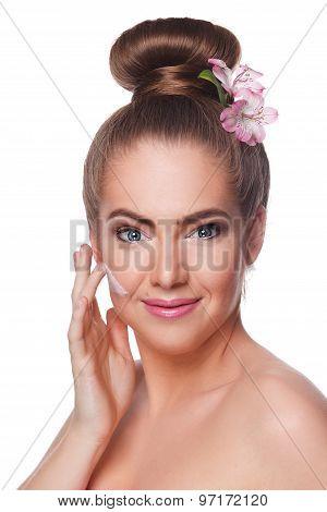 Beautiful Woman Putting Face Cream On