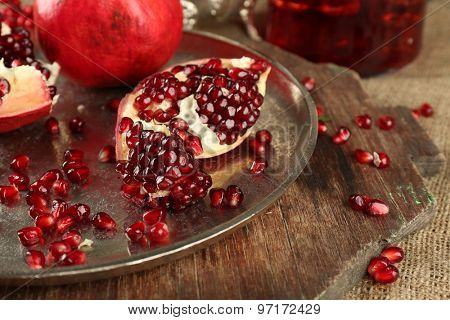 Pomegranate seeds on metal tray, closeup