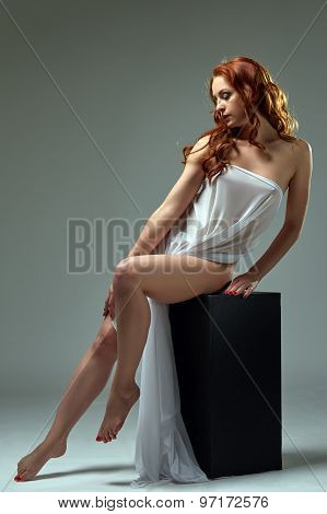 Graceful red-haired model posing in erotic outfit