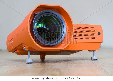 Projector with a big lens.