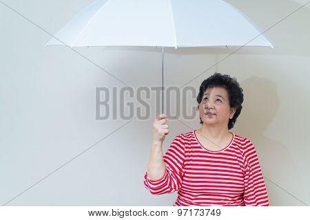 Asian Woman Holding Umbrella In Studio Shot, Specialty Tones