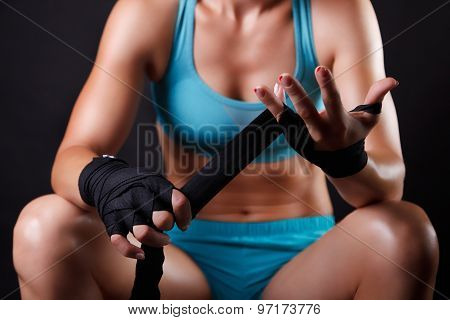 Woman Putting Boxing Bandage On Her Hands