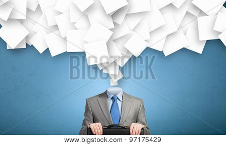 Faceless businessman with pile of papers flying on air