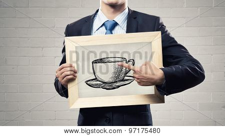 Close up of businessman with wooden frame