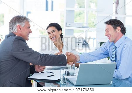 Business people reaching an agreement in an office