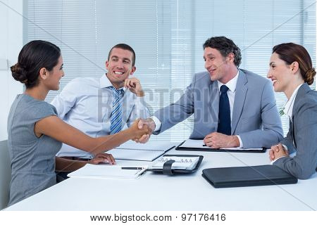 Business team greeting each other in the office