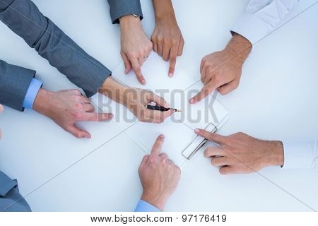 Business team pointing clipboard in the office