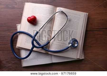 Stethoscope on books on wooden background