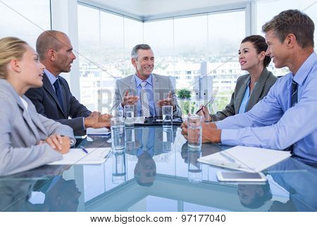 Business colleagues discussing about work in the office