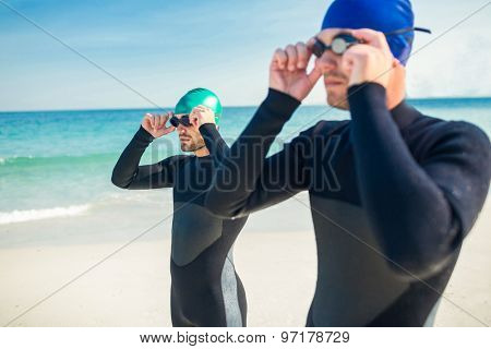 Swimmers getting ready at the beach on a sunny day