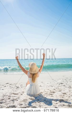 beautiful blonde woman on a sunny day at the beach