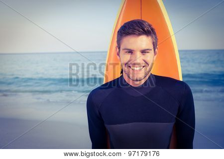 Man with surfboard in swimsuits on the beach
