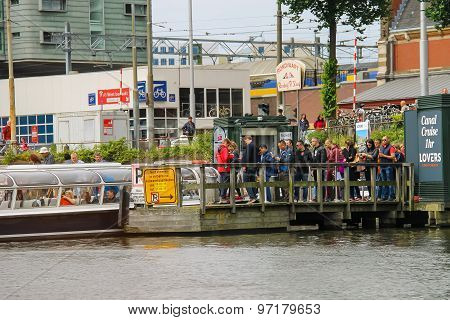 People On The Dock Landing On River Cruise Ships, Amsterdam, Netherlands