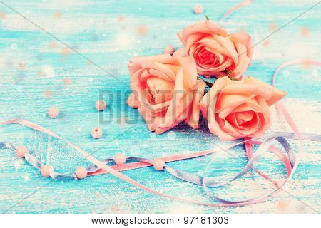 Beautiful roses on blue wooden background