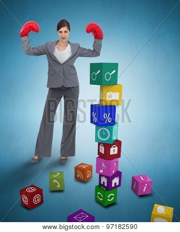 Businesswoman with boxing gloves against blue vignette background
