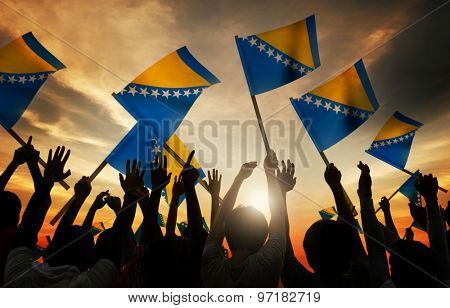 Silhouettes of People Holding Flag of Bosnia