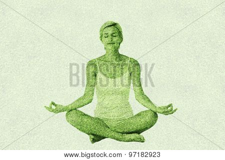Fit woman doing yoga against astro turf surface Fit woman doing yoga on white background