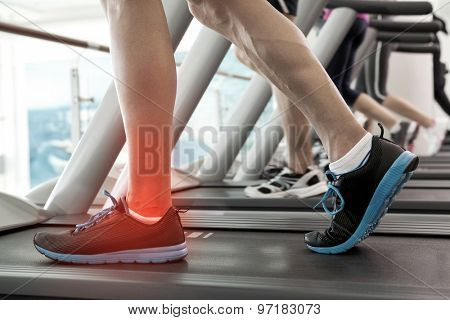 Digital composite of Highlighted ankle of man on treadmill