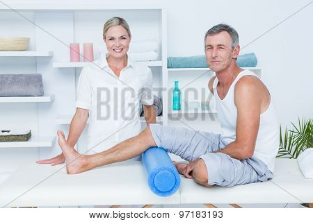 Patient and doctor looking at camera in medical office