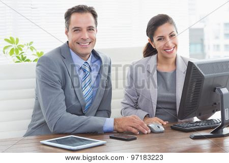 Smiling business partners working together in an office