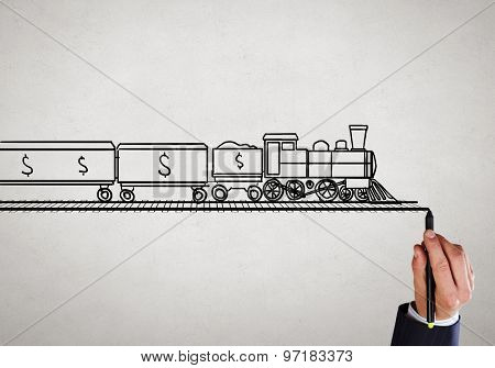 Close up of male hand drawing transportation train