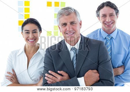 Smiling business people brainstorming together in an office