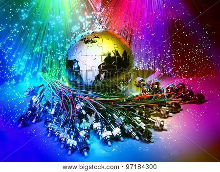 glass earth with network against fiber optic background