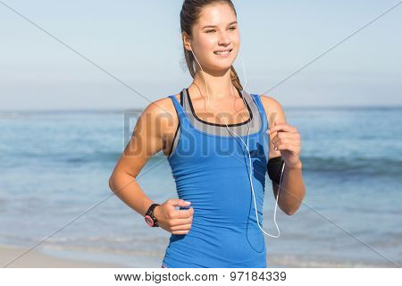Fit woman doing jogging at the beach