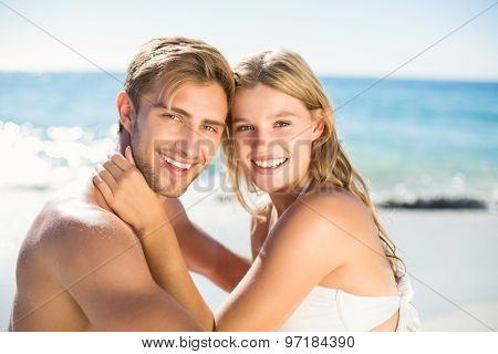 Happy couple in swimsuit at the beach