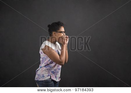 African Woman Shouting Or Screaming On Blackboard Background