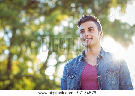 Handsome hipster looking to the distance on a sunny day