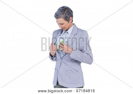 Businesswoman hiding money in her suit on white background