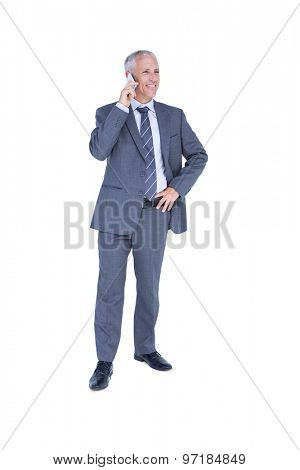 Handsome businessman having phone call on white background
