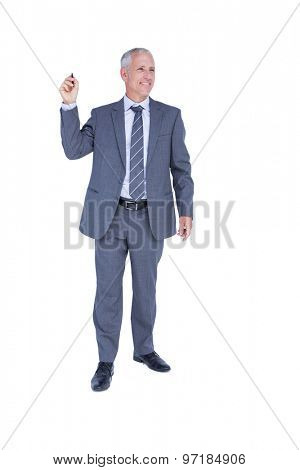 Smiling businessman pointing something with his hand on white background
