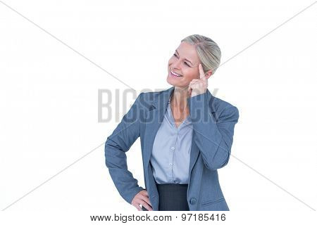 Businesswoman thinking with finger on head against a white background