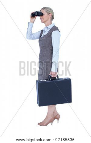Profile of a businesswoman using a binocular on a white background