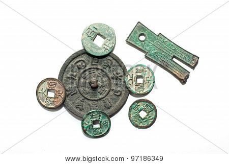 Ancient Chinese bronze coins on a white background